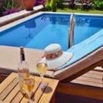 Enjoying a cool wine around the pool at Villa Acacia