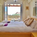 Master bedroom with doors onto main balcony